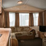 Seating area in Harlyn Budget Caravan