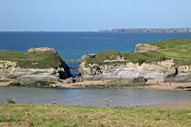 Views of Porth Beach, at high tide, on the coastal path to Newquay
