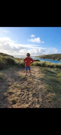 My little explorer looking out to sea at Crantock in search of mermaids